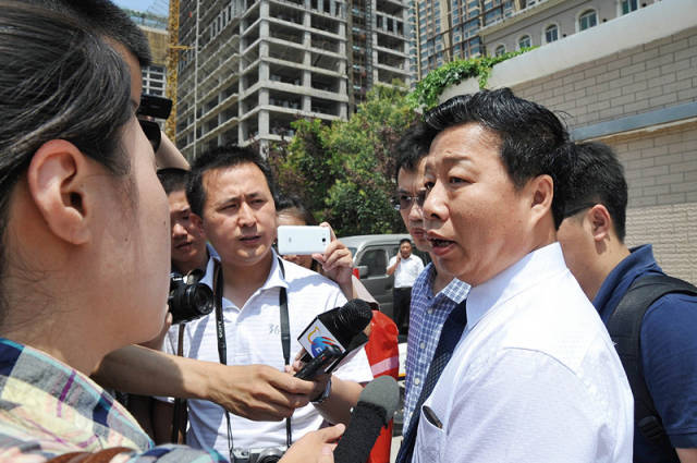 Wang's Defense Lawyer Zhu Aimin (right) after the trial