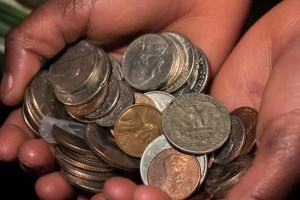 Steven Depolo - Black Hands Holding Coins via flickr