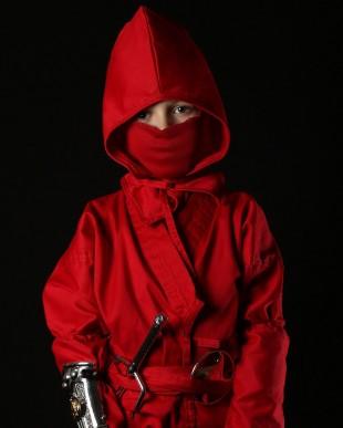 En ung cosplayer som as The Red Ninja Ranger fra Mighty Morphin Power Rangers under New York Comi Con 2014. (Foto: NTBScanpix, Neilson Barnard)