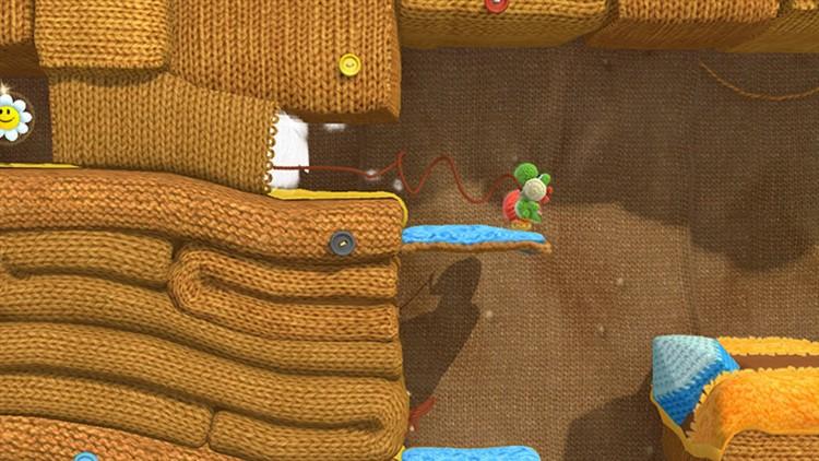 Yoshi trekker i tråder for å åpne hemmelige ganger. (Foto: Nintendo)
