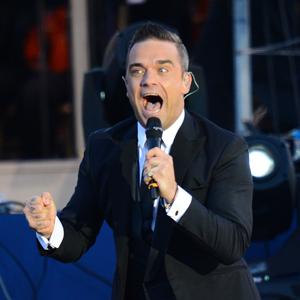 """Robbie Williams' """"Angels"""" blir ofte spilt i britiske begravelser. (Foto: NTB Scanpix, AFP, Leon Neal)"""
