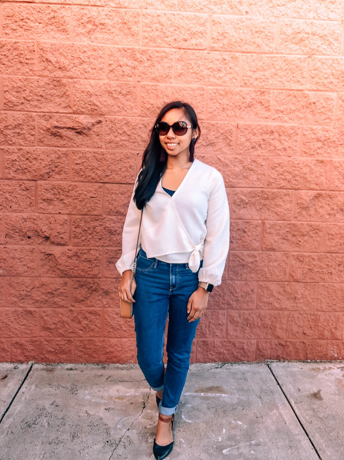 Madewell wrap top, jeans, and pointed flats