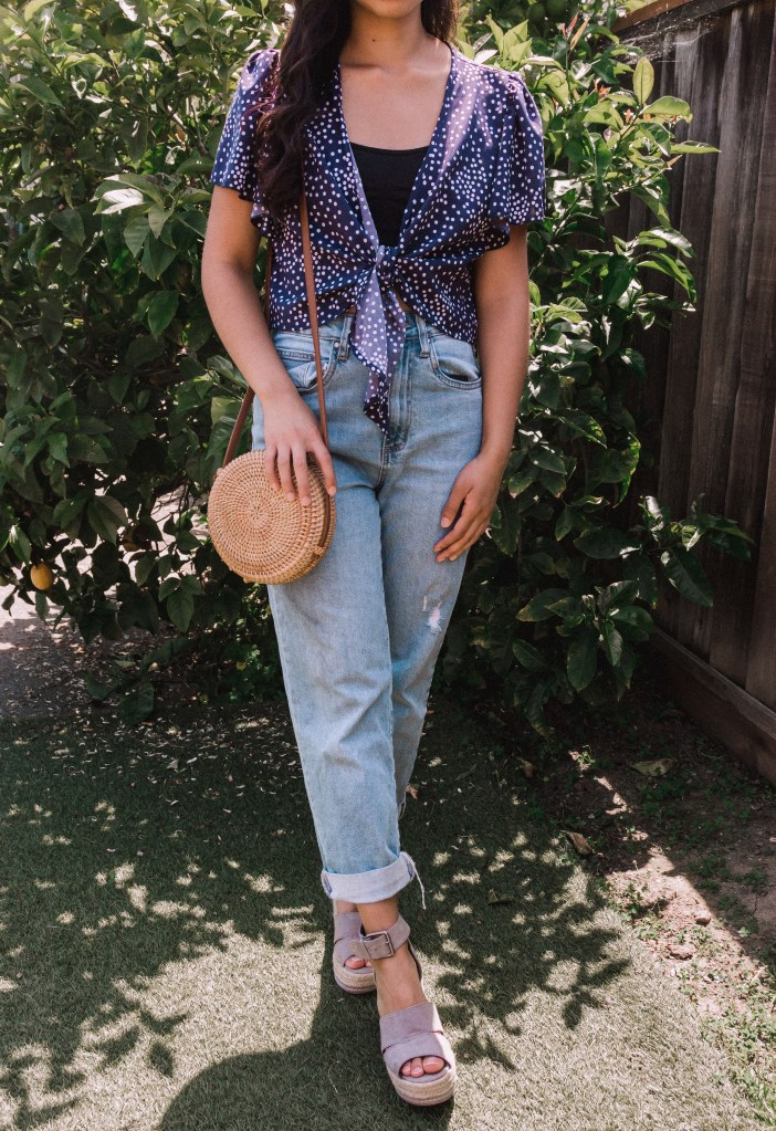 Polka Dot Top and Jeans | Are you looking for cute summer outfits for 2020? In this post, I mixed and matched 5 pieces to create 5 cute summer outfits for less than $40 total! These are easy and casual summer outfits that you can recreate. Read this post to get inspired right now!