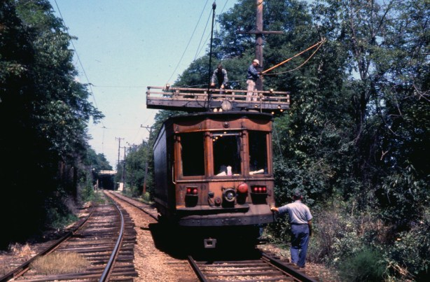 Port Authority line crew trims branches away from communication and feeder wires near Hillcrest in Bethel Park, 1967.