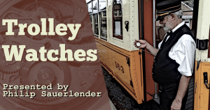 Banner advertising program shows a watch interior with gears with Trolley Watches text superimposed next to a photo of a trolley operator looking at a pocket watch pictured at Rockhill Trolley Museum.