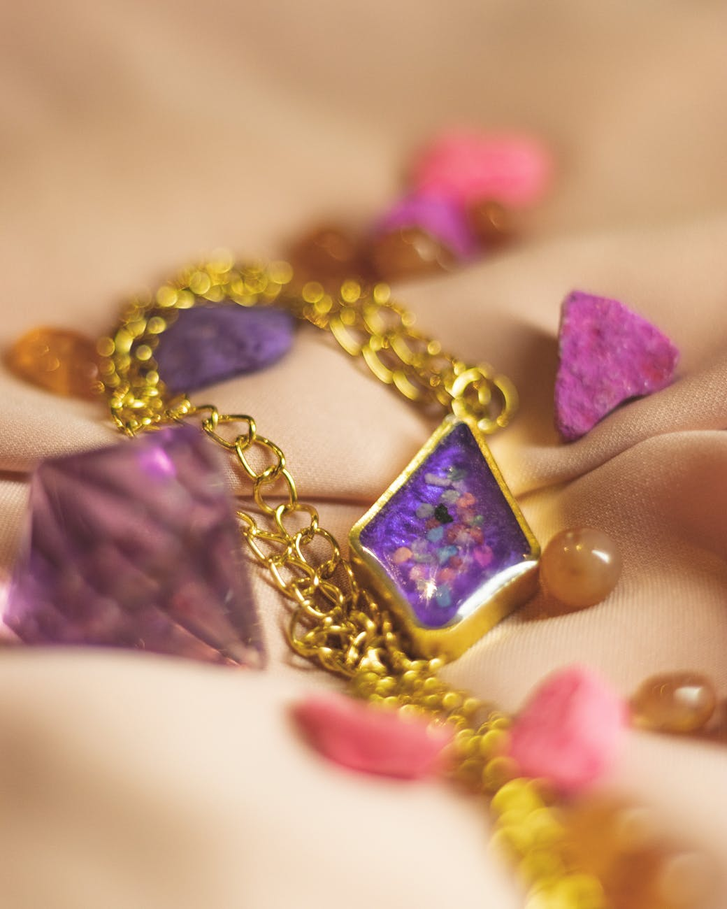 gold and purple gemstone necklace
