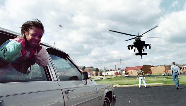While covering a Veteran's Day event, I knew the Blackhawk had to take off. As the time got close, I sought out a good composition and waited. I did not expect the girl's reaction.