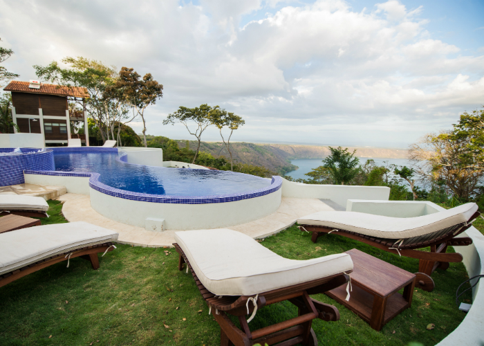Infinity pool overlooking a crater lake at Pacaya Lodge & Spa