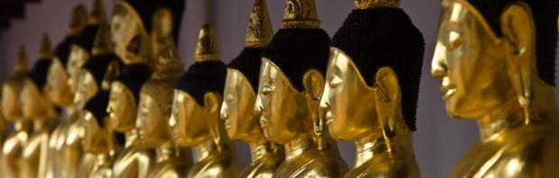 Buddha statues inside Wat Phra Borommathat, Chaiya