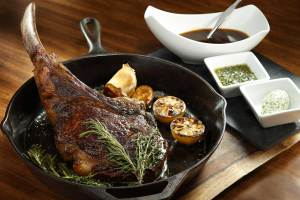 54-ounce Mishima Prime Tomahawk Ribeye steak is cooked to perfection and served alongside Chef Morimoto's signature sweet onion and garlic jus.