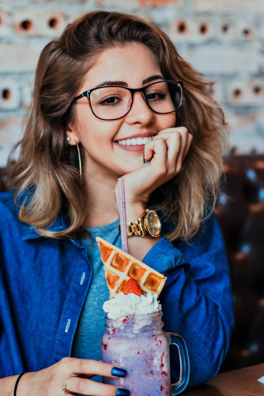 smiling girl having ice cream