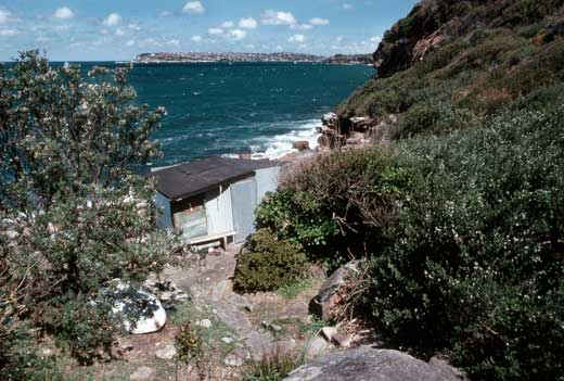 The view south over Sydney Harbour shows the Men's Hut, built in the late 1920s, in the foregraound.