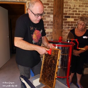 Doug Purdie demonstrates honey extraction.
