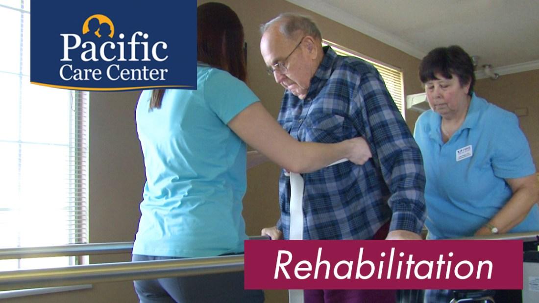 Nurses Helping A Man In Rehabilitation