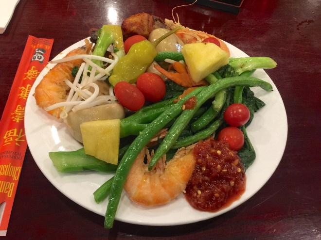 Shrimps, tomato, beans, pineapple, chicken drum sticks and mushrooms