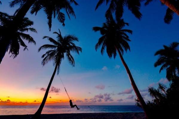 active person swinging on beach after prp joint rejuvenation