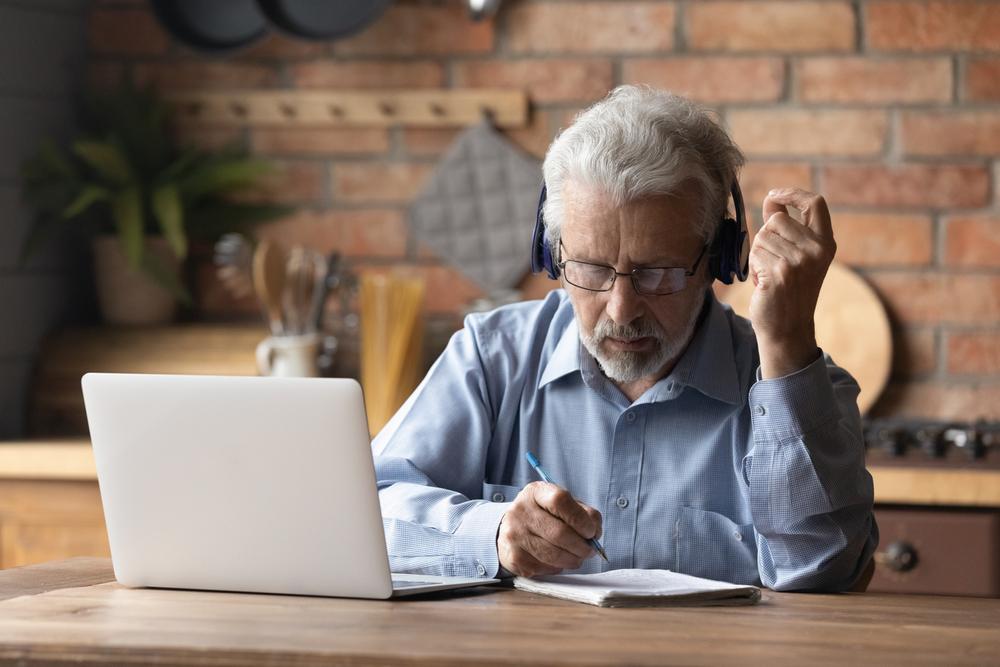 senior man listening to integrative health services course