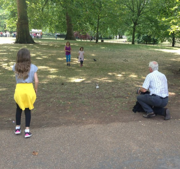 Granddad with his granddaughters, 'taming' a squirrel