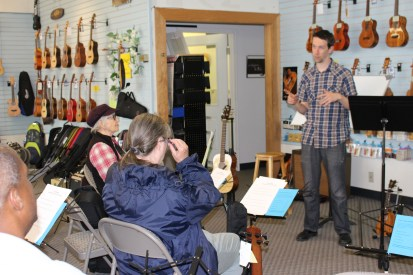 Milo Fultz teaching an 'ukulele bass workshop