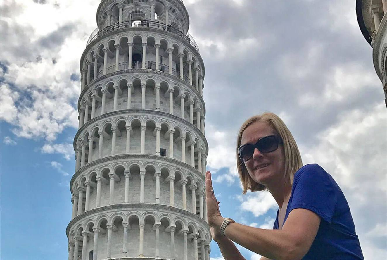 Holding the Tower of Pisa tourist photo. Tuscany. Italy