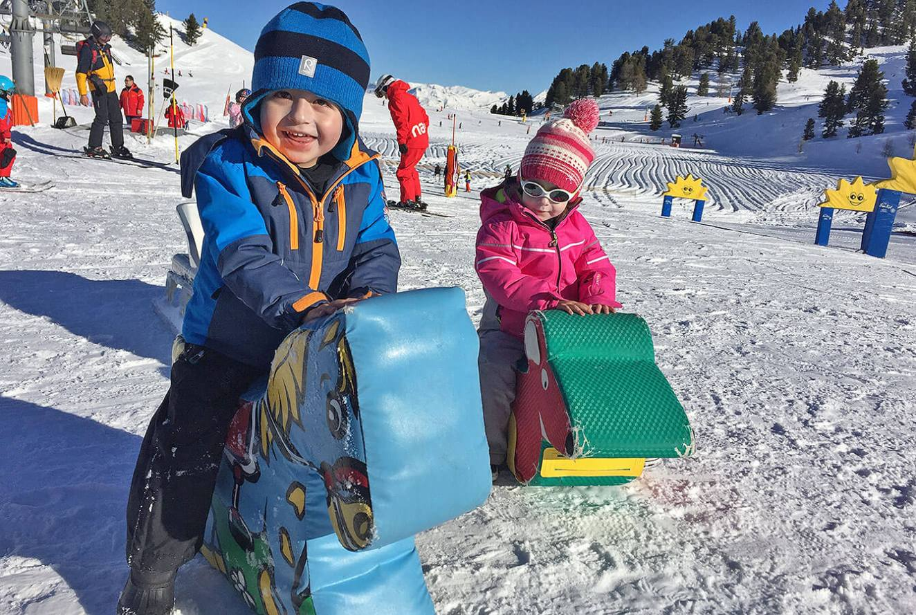 kids on snow horses in ski resorts