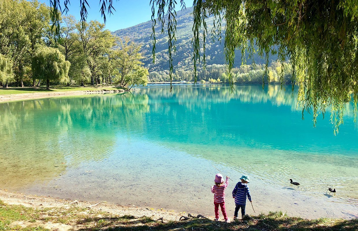 kids standing by a lake