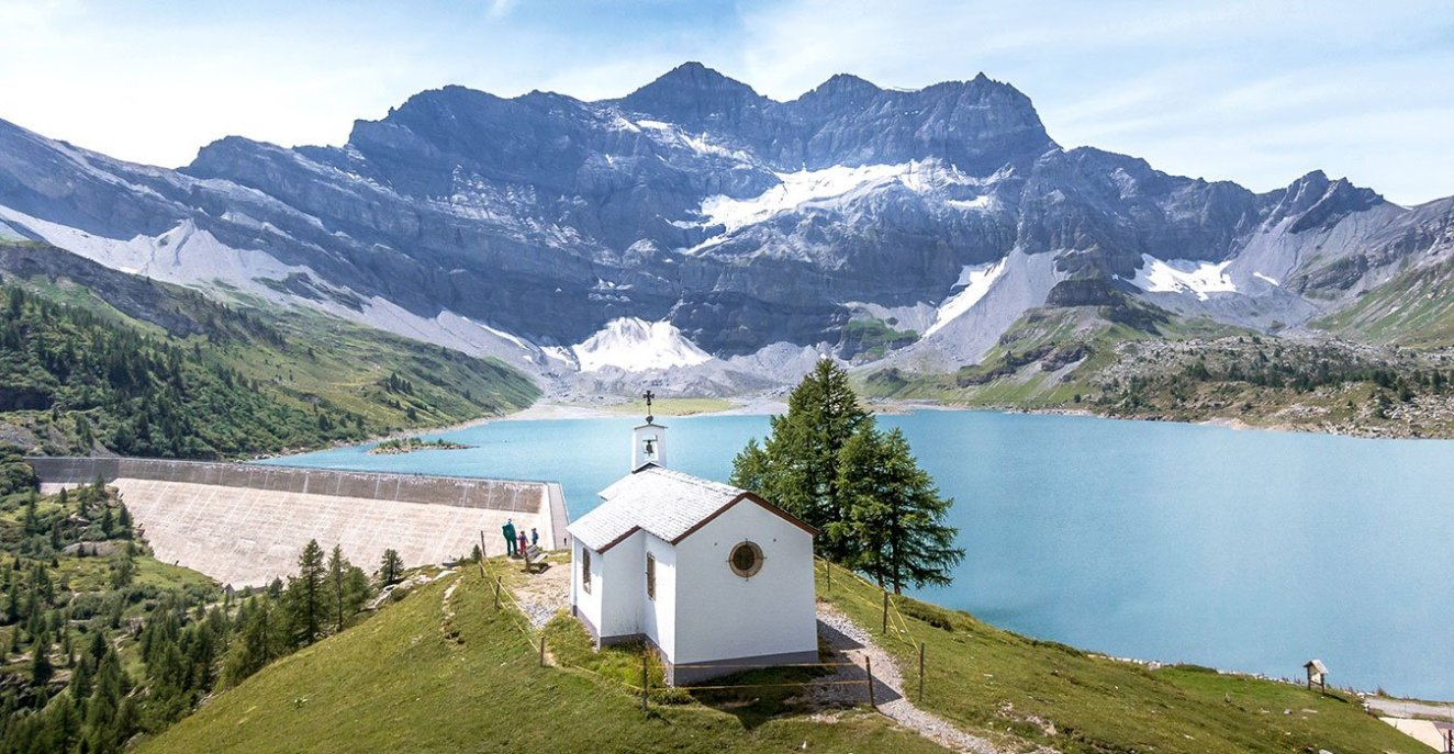 chapel with mountain lake