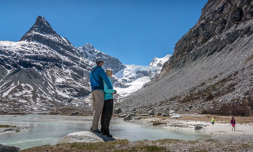 Couple standing at Mont-Miné Glacier at the end of the Ferpècle Valley