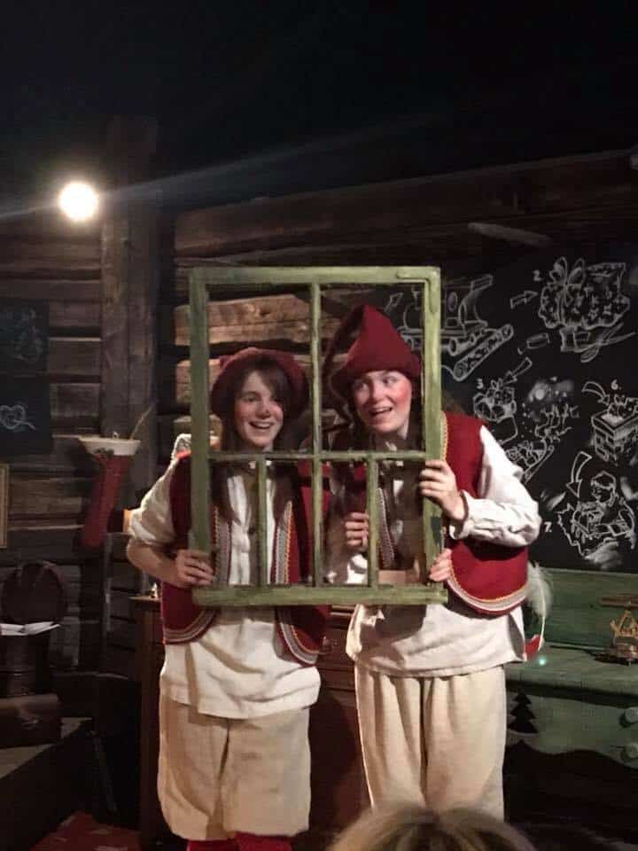 Two elves behind a window