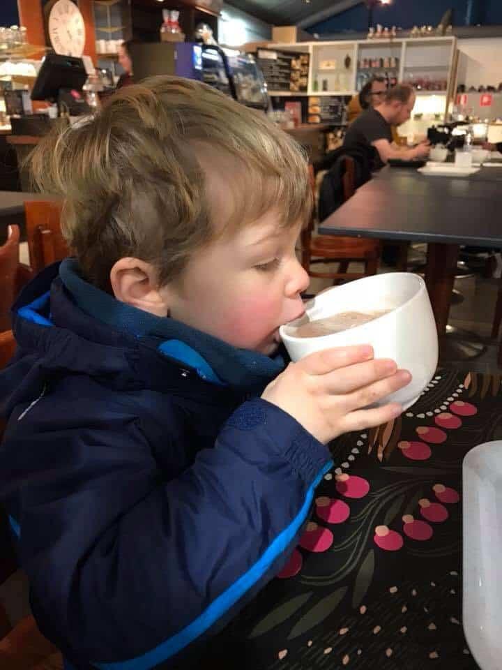Boy drinking hot chocolate