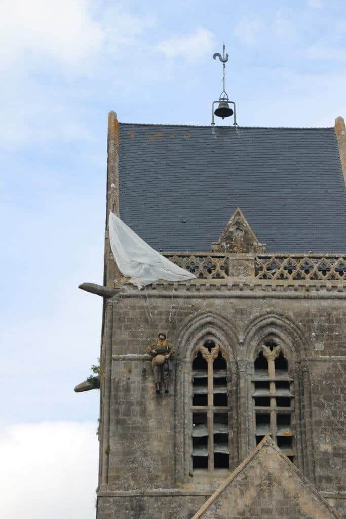 John Steele (dummy) hanging from the church steeple where he landed on D-day in St. Mere Eglise. He survived the war.