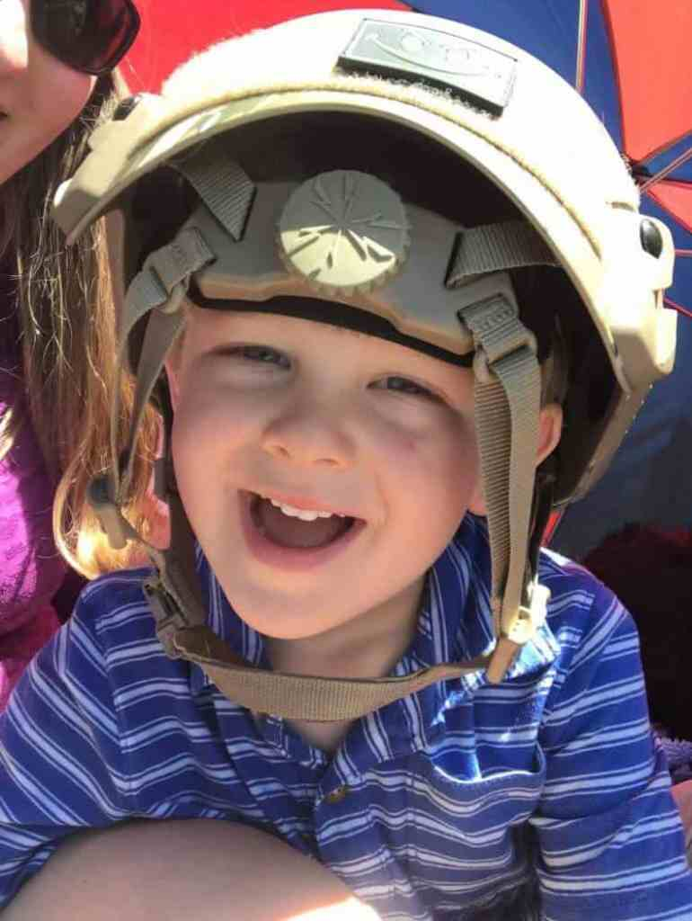 Boy wearing a paratrooper hat.