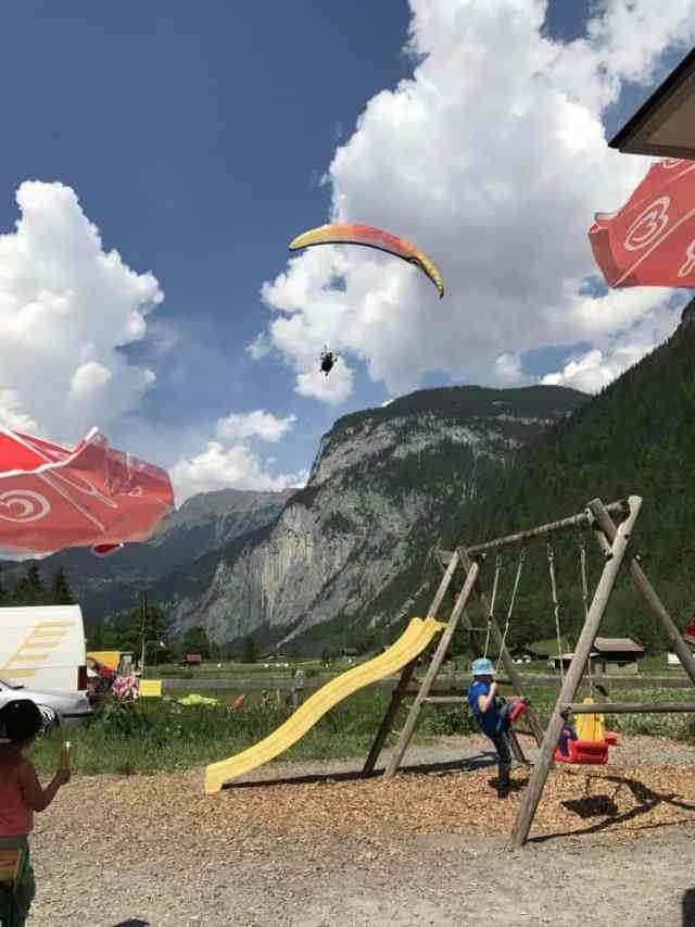Stechelberg Valley Station Cafe with Paragliders