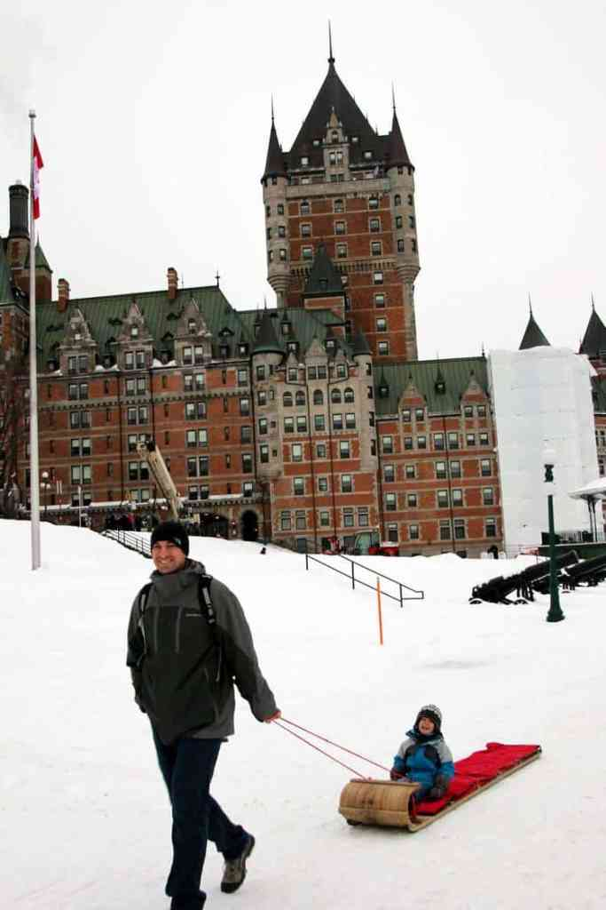 Tobogganing in front of Château Frontenac,