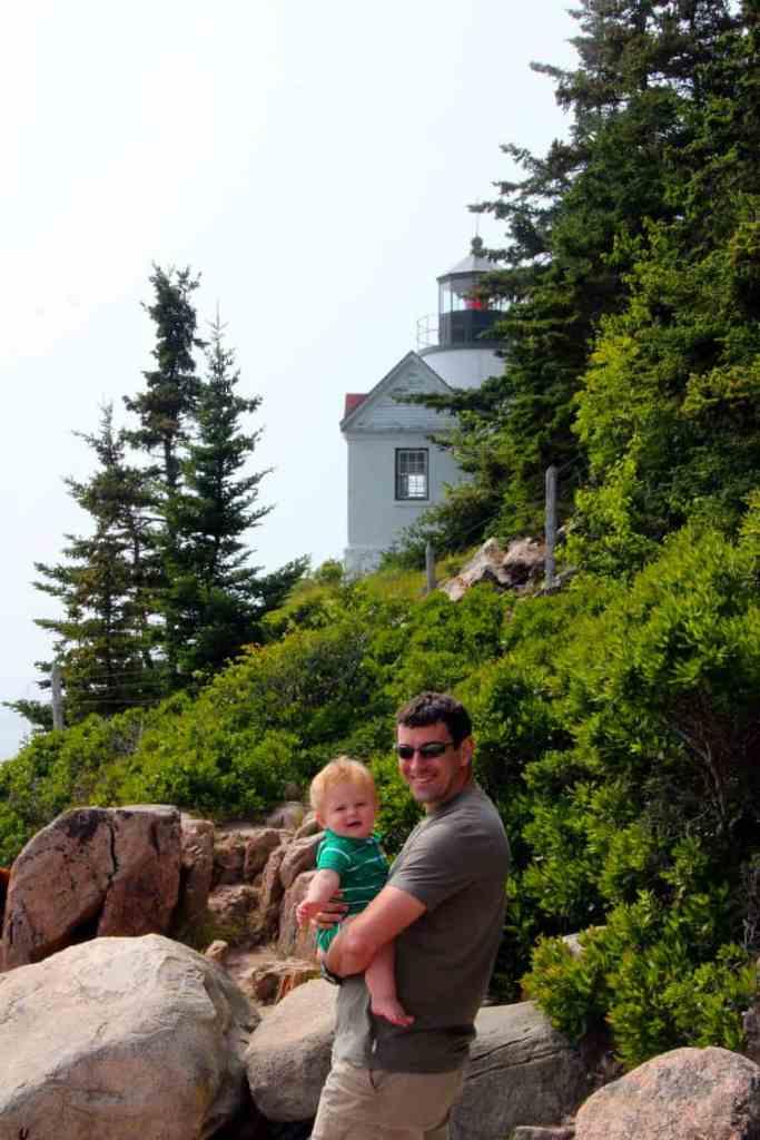 Bass Harbor Head Lighthouse near Bar Harbor maine with a father and his son.