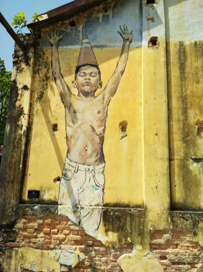 """Art is rubbish"" by Ernest Zacharevic"