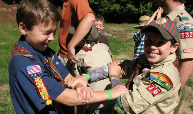 Cub Scouts learning a first aid carry