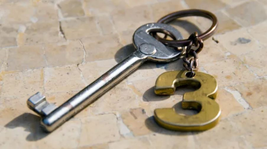 """Key with a """"3"""" emblem attached"""
