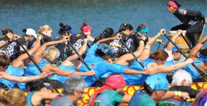 Dragon boat teams racing