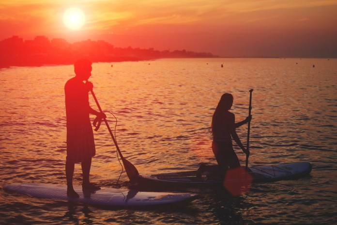 how to paddle board surf