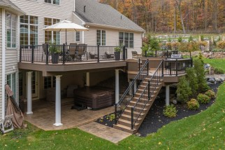 Custom built three-tier deck with stairs leading to yard.