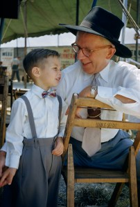 A man and boy talk in Pennsylvania Dutch dialect at a festival.