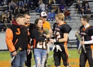 Aubree accepting senior day flowers for her brother