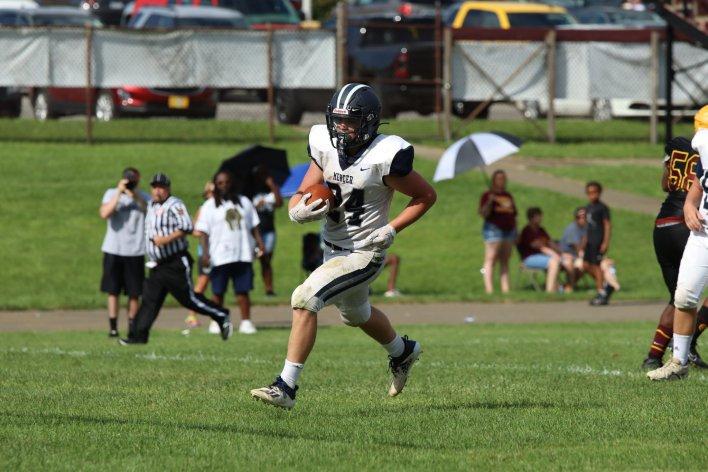 Senior Running Back Jake Badger running the football. Photos by Sykotyk.