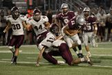 Mechanicsburg QB Jeff Lougee carries for the Wildcats.
