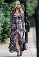 caprice spotted in a phone call on her way to a meeting in west london 13. o 128w 186h