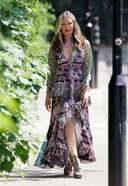 caprice spotted in a phone call on her way to a meeting in west london 3. o 128w 186h