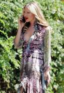 Caprice Spotted In A phone Call On Her Way To A Meeting in West London