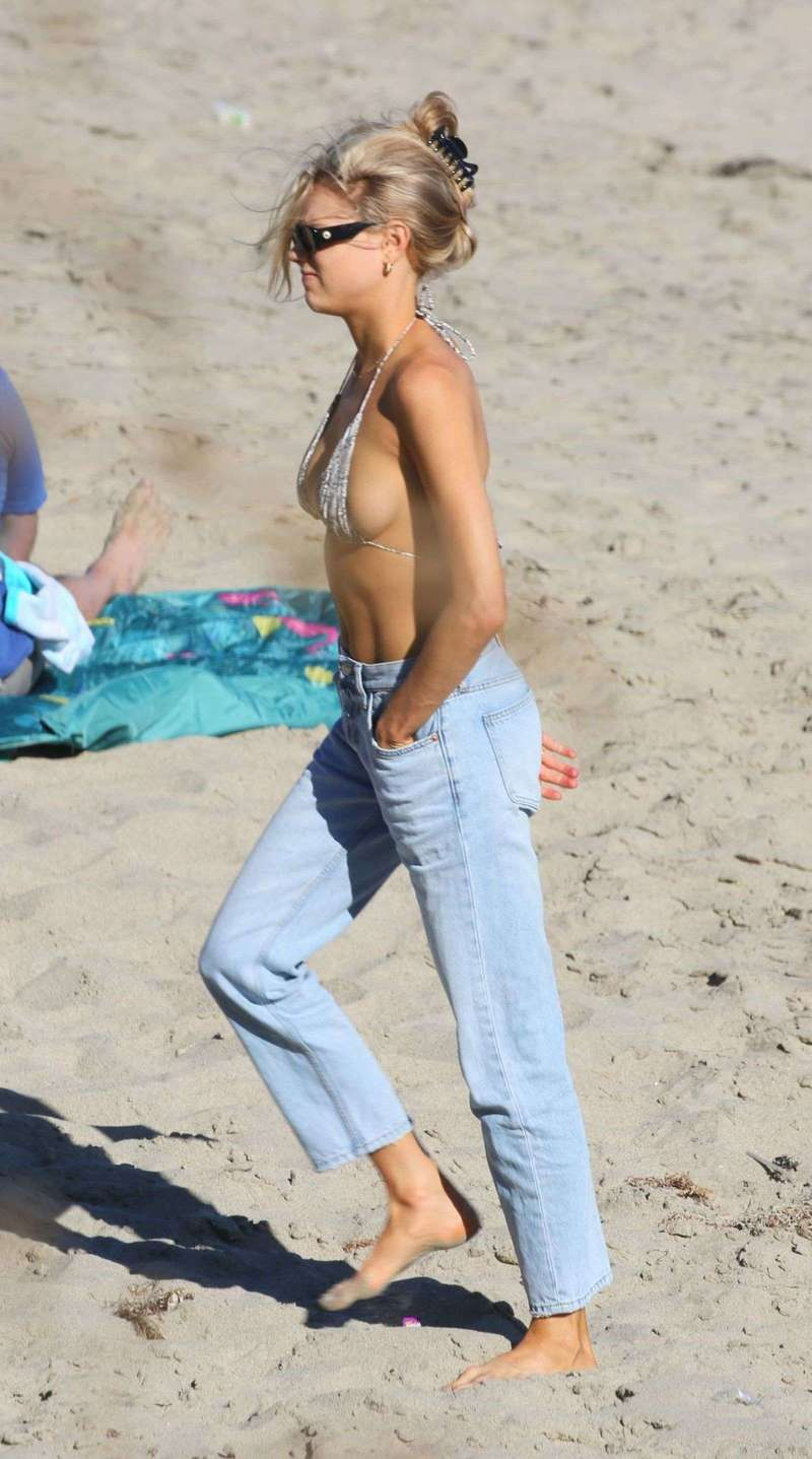 Charlotte McKinney hits the beach with a friend in Los Angeles