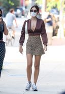 Emily Ratajkowski shows off her legs while out for a walk with a friend in New York